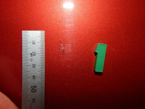 Закрашенный скол, выявленный при оценке качества ремонта ТС